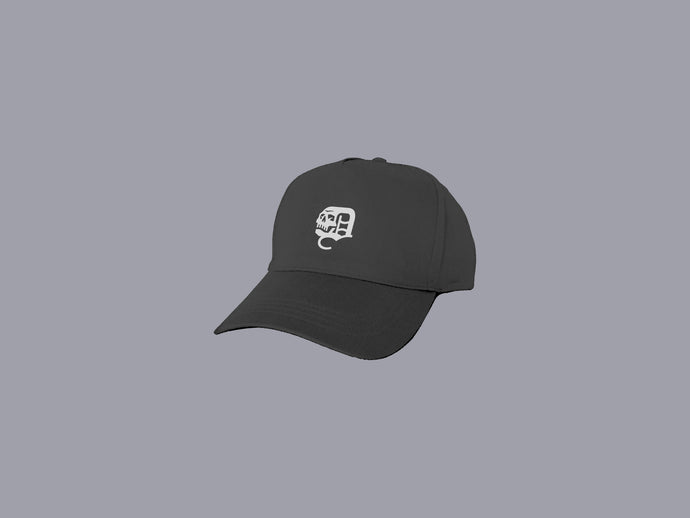 Black Classics dad hat with adjustable strap and embroidered white Old English skull icon | DSTNT Culture