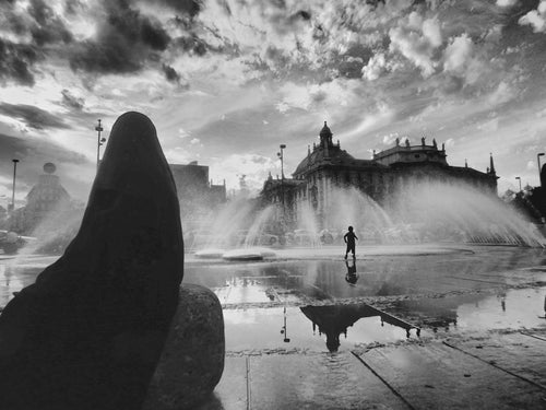 Arab mother and son, Karlsplatz Fountain  Munich Germany - Travel wall art prints by Edwin Datoc Gallery