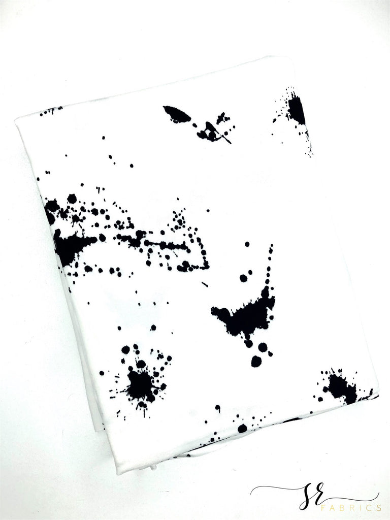 Black and white splattered paint brushed poly knit