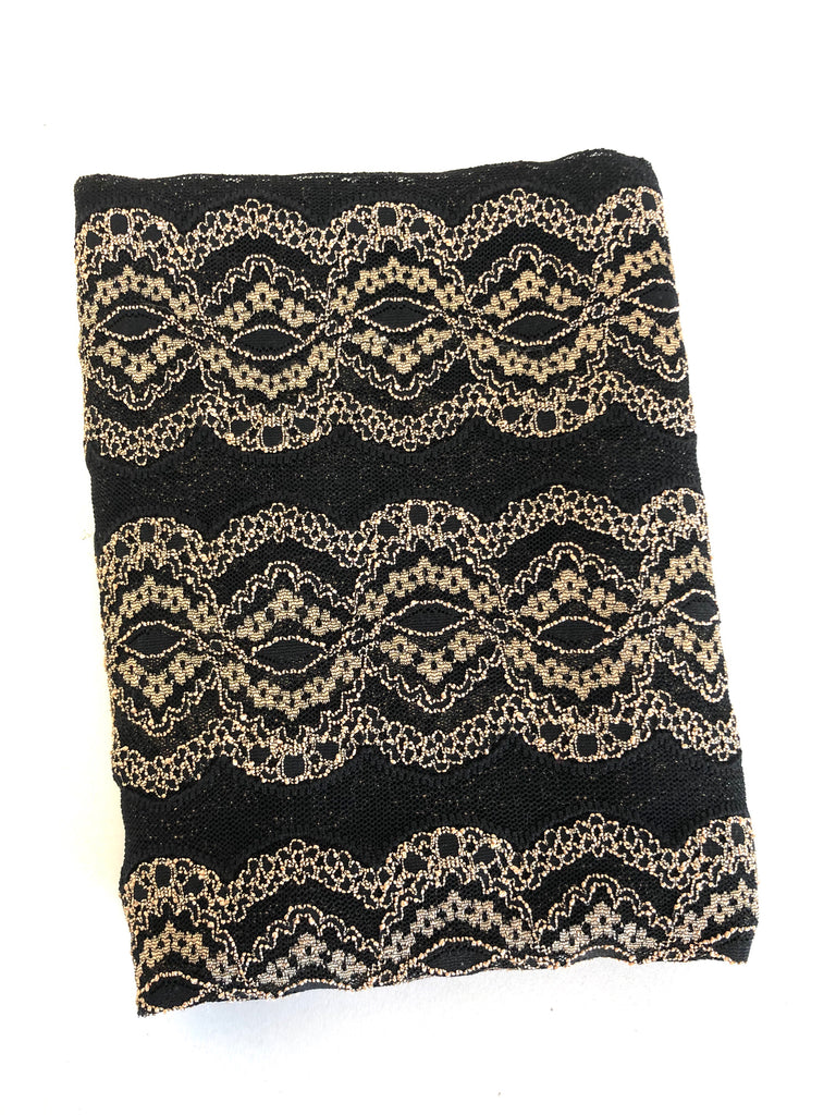 Gold and black stretch lace knit  $5 and below