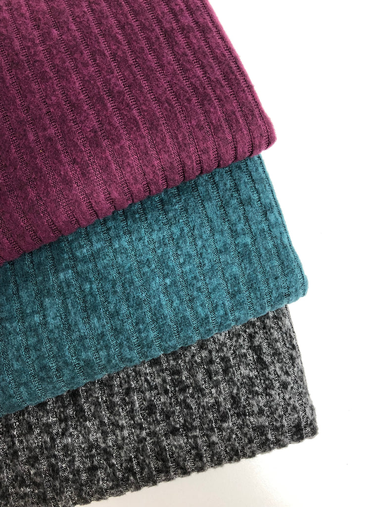 Rich colored heathered brushed rib hacci knit