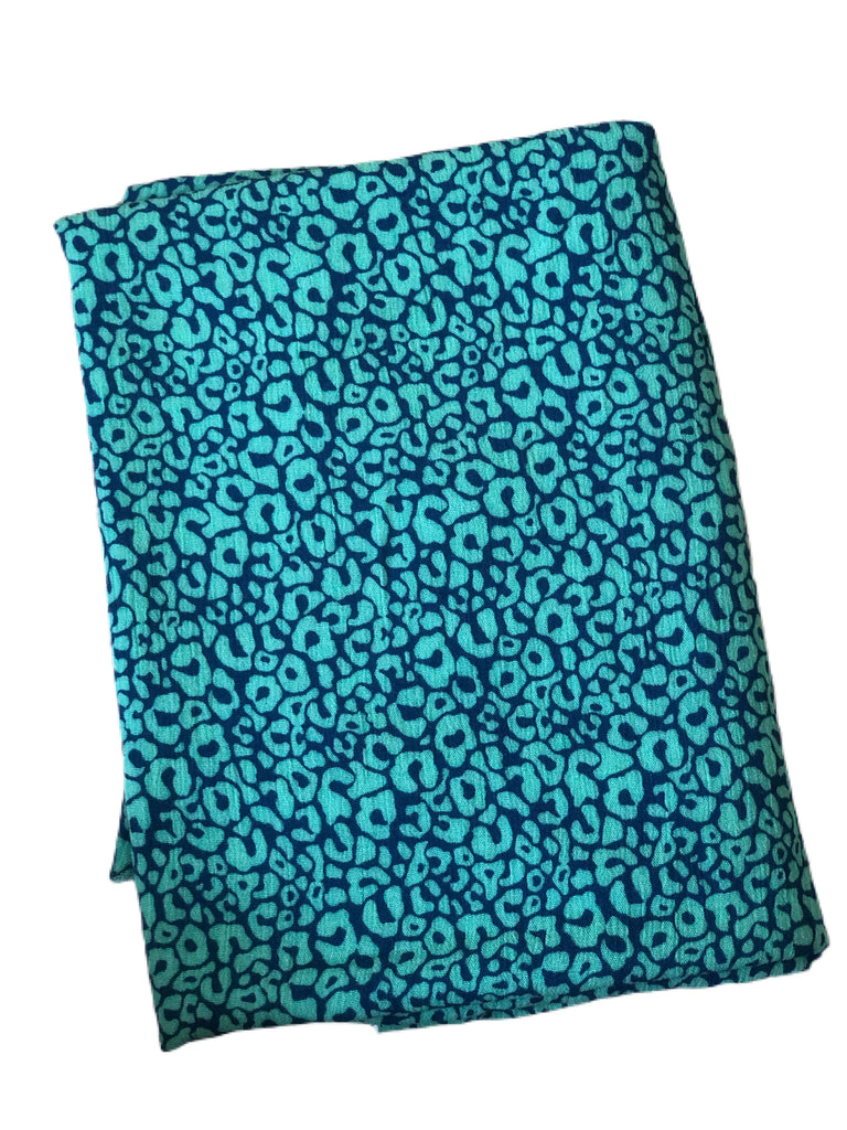 Teal and blue cheetah rayon crepe woven