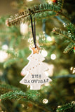 "Christmas tree shaped porcelain clay ornament, with gold star and gold ornaments, hand-stamped personalization with ""The Bagwells"""