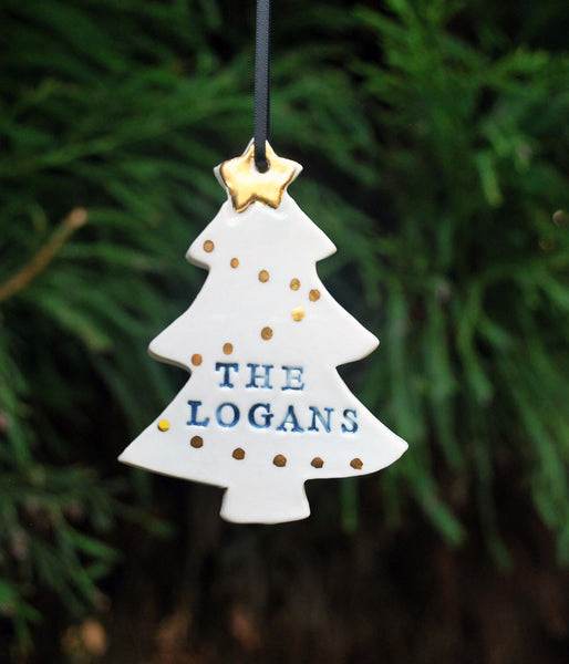 "Christmas tree shaped porcelain clay ornament, with gold star and gold ornaments, hand-stamped personalization with ""The Logans"""