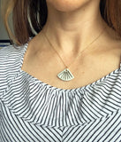 Porcelain necklace in fan shape, aqua color with gold luster vertical stripes, worn on the neck