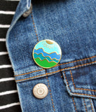 Blue Ridge Mountain enamel pin on a jean jacket