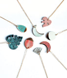 Grouping of ceramic porcelain necklaces in green, aqua, pink and white