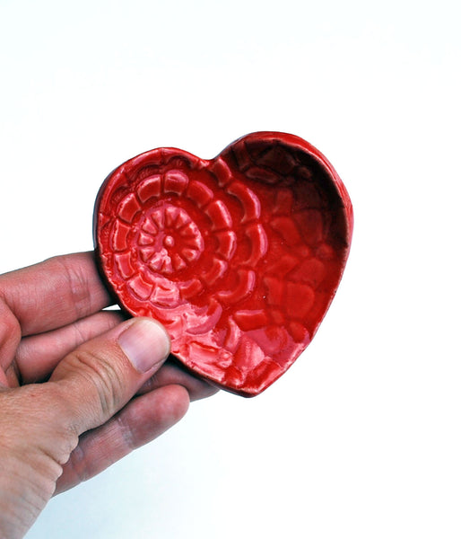 red ceramic heart dish
