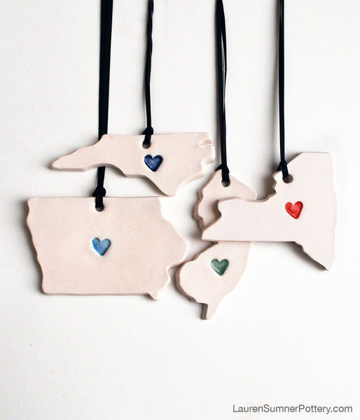 Porcelain ornaments in state shape with a heart
