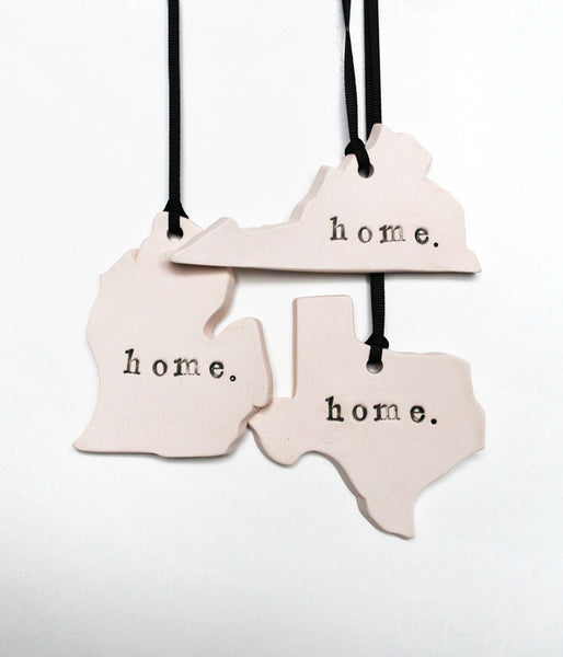 State ornaments with home stamped on them. States seen in this image include Michigan, Virginia and Texas.