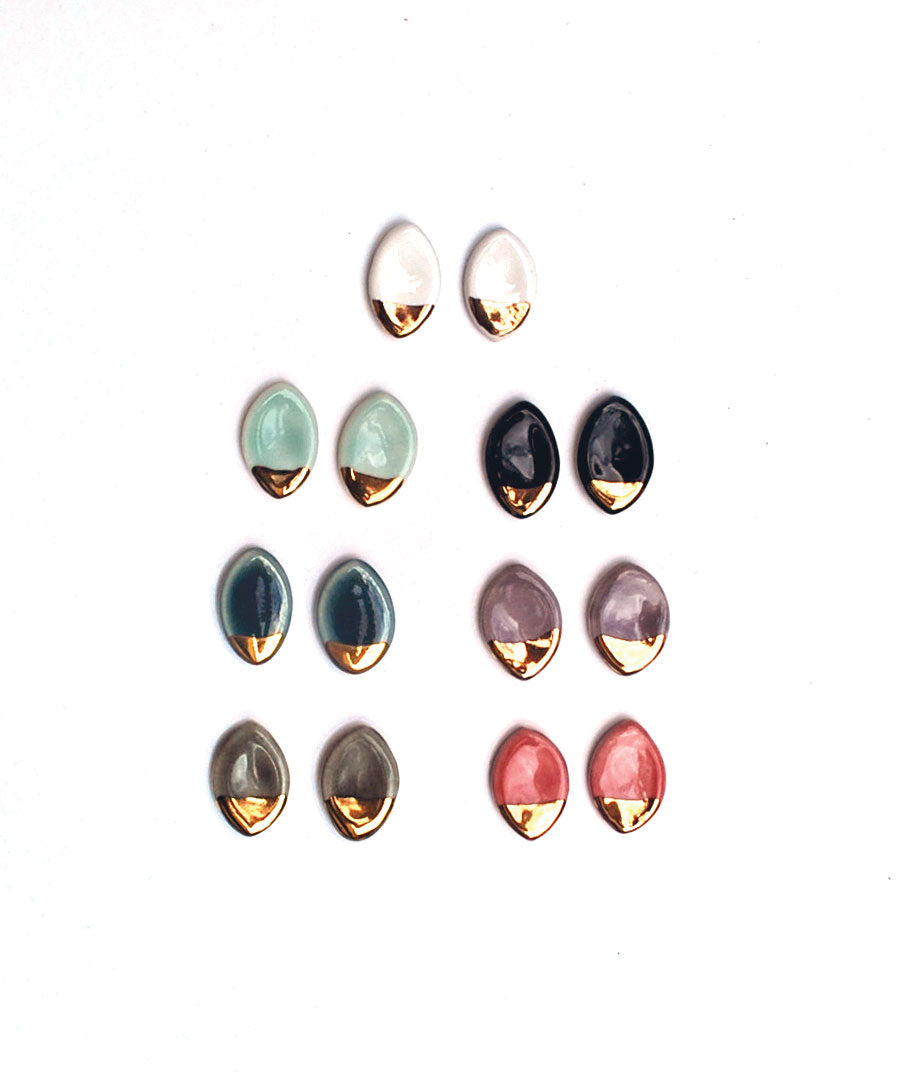 Oval stud earrings with gold luster bottoms