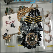 Mode necklace in black OptimismIC Gift Shop 6603 Queen Avenue S Minneapolis, MN 55423 612-259-7454