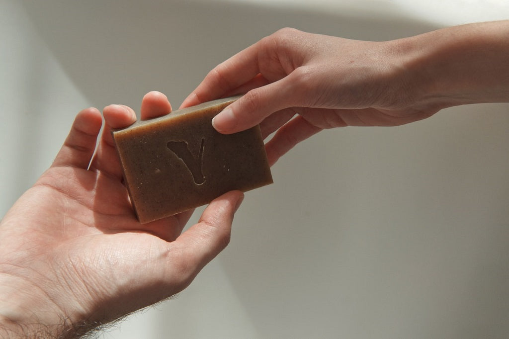 Handing over a bar of soap
