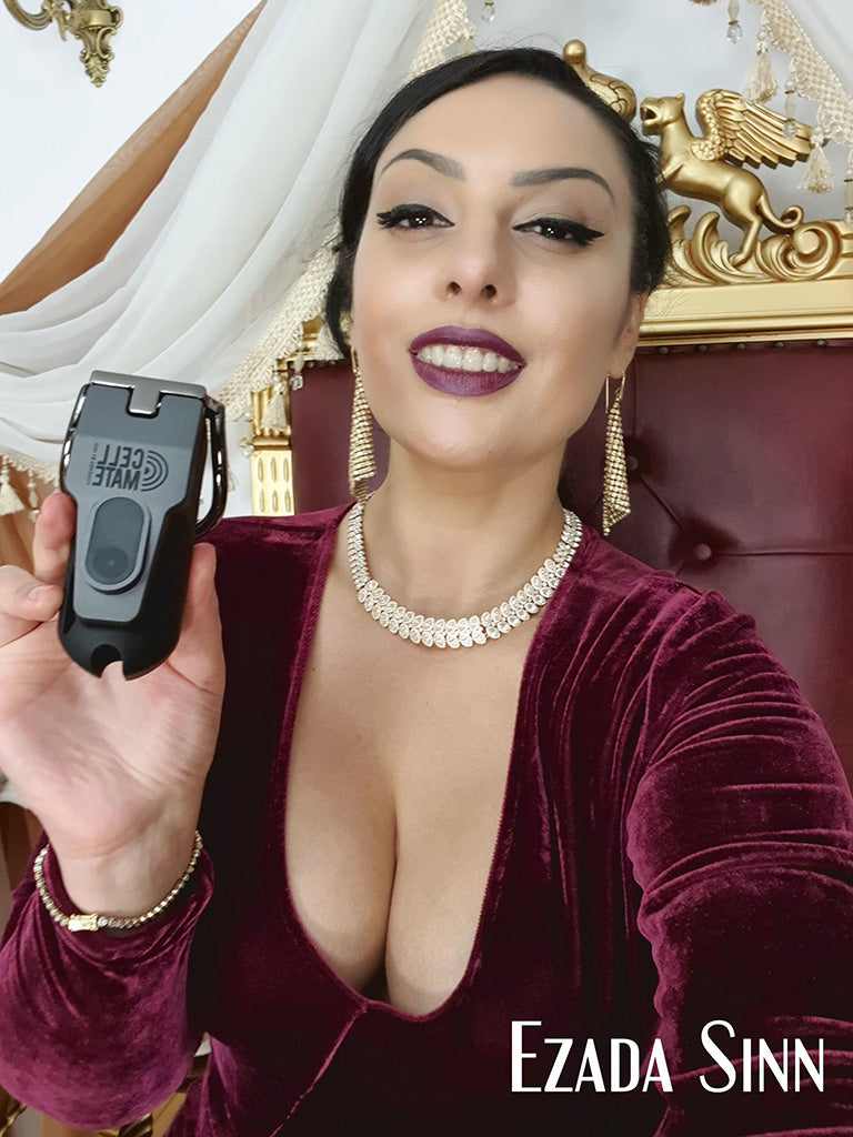Mistress Ezada Sinn holding a Cellmate chastity device