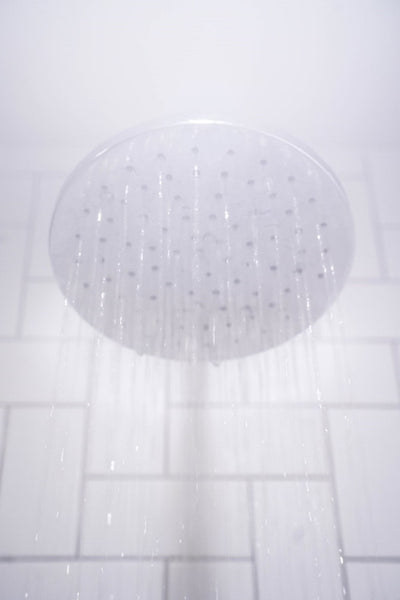 Shower head with water flowing from it