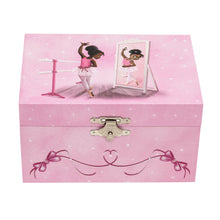Pink music box with an image of a black ballerina dancing in a long mirror.