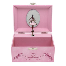 Pink music box both inside and outside opening displaying a African American ballerina figurine inside the box.