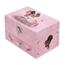 Pink music box with an image of a African American Ballerina sitting at a dressing table.