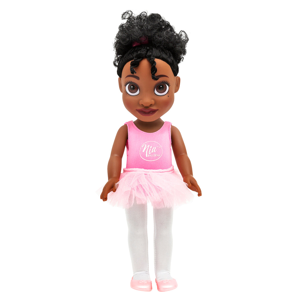 Black Ballerina Doll wearing a pink ballet outfit complete with tutu and matching ballet shoes, and white whites. Doll has black hair tied up with pink bobbles. Doll is made of plastic and medium brown in colour.