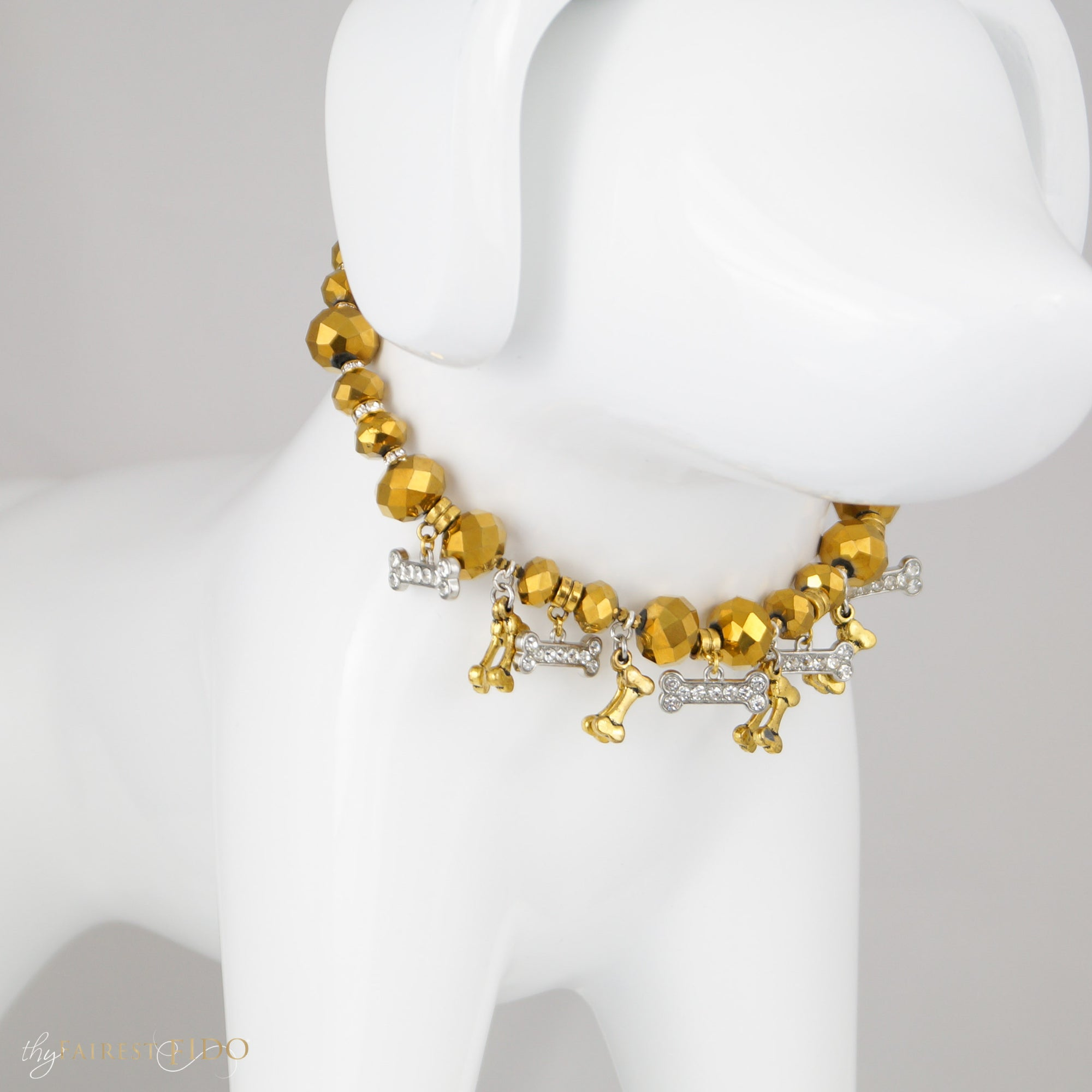 Bone Collector Golden crystal beads with golden bone dangles and rhinestone bone dangles size  1