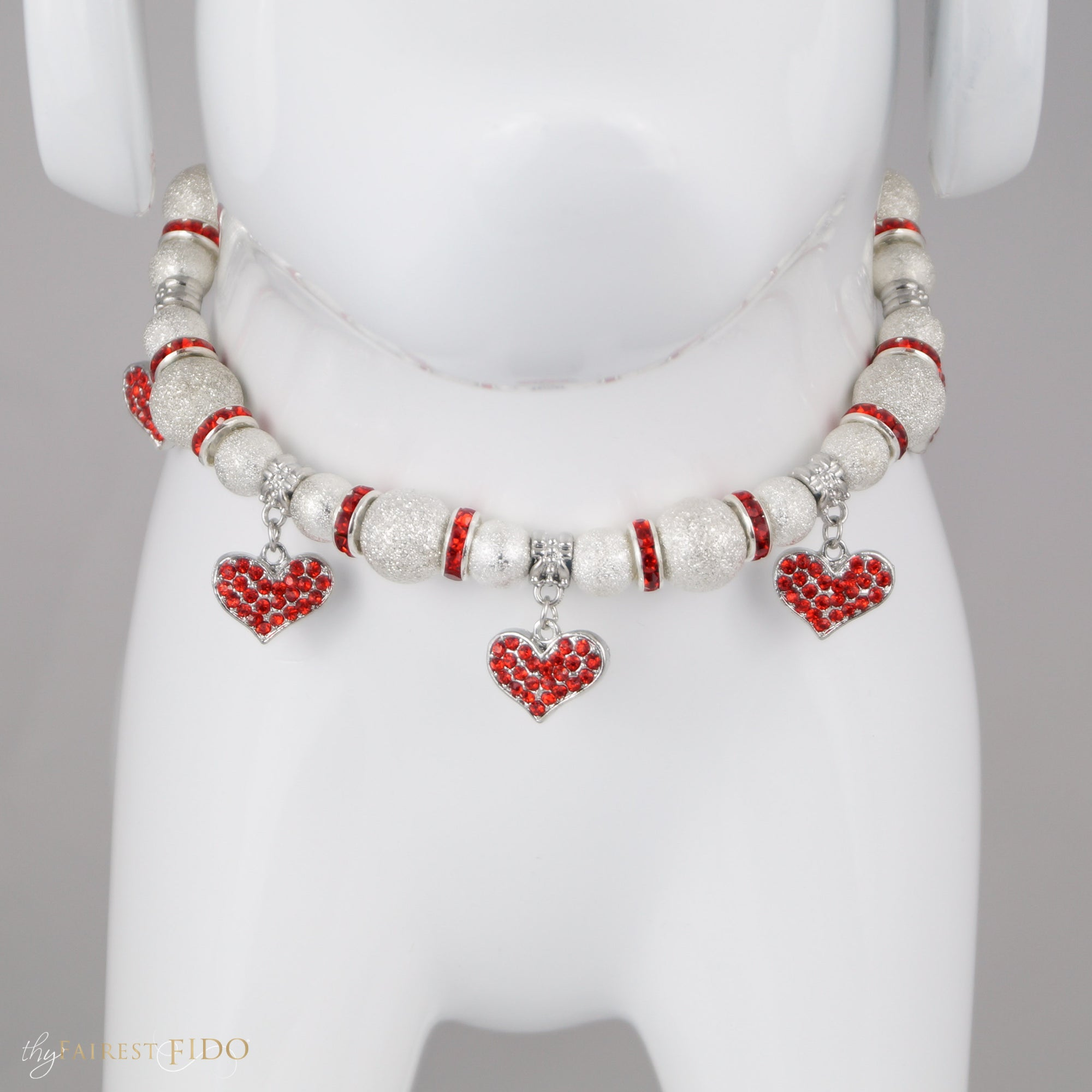 Cascade Hearts Silver stardust necklace with red rhinestone dangle hearts front view