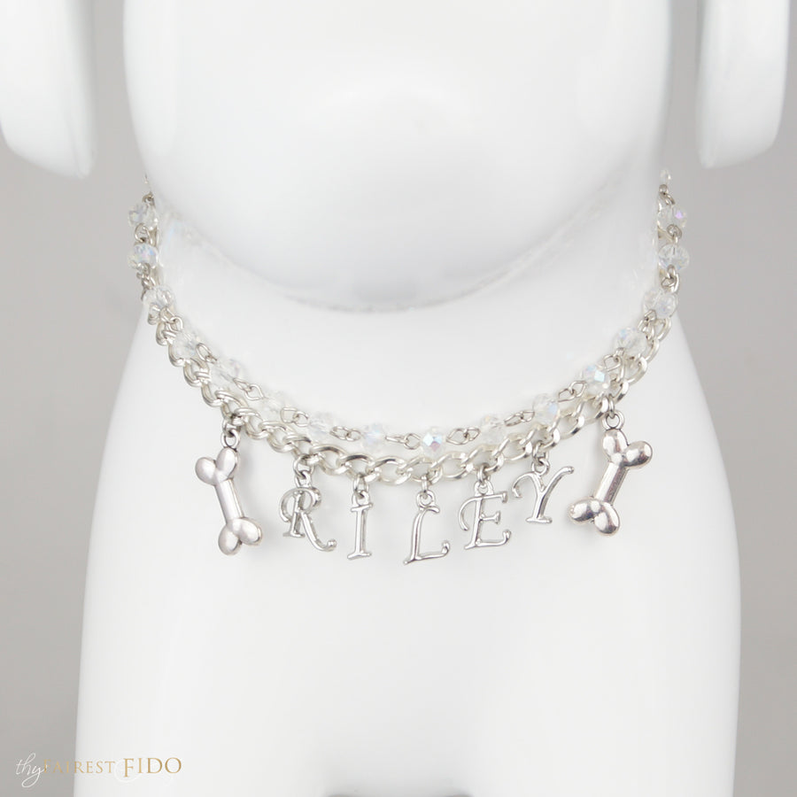 Fido's Flair, Silver Curb chain personalized with dog's name Script Letter dangles in between two silver dog bone dangles.