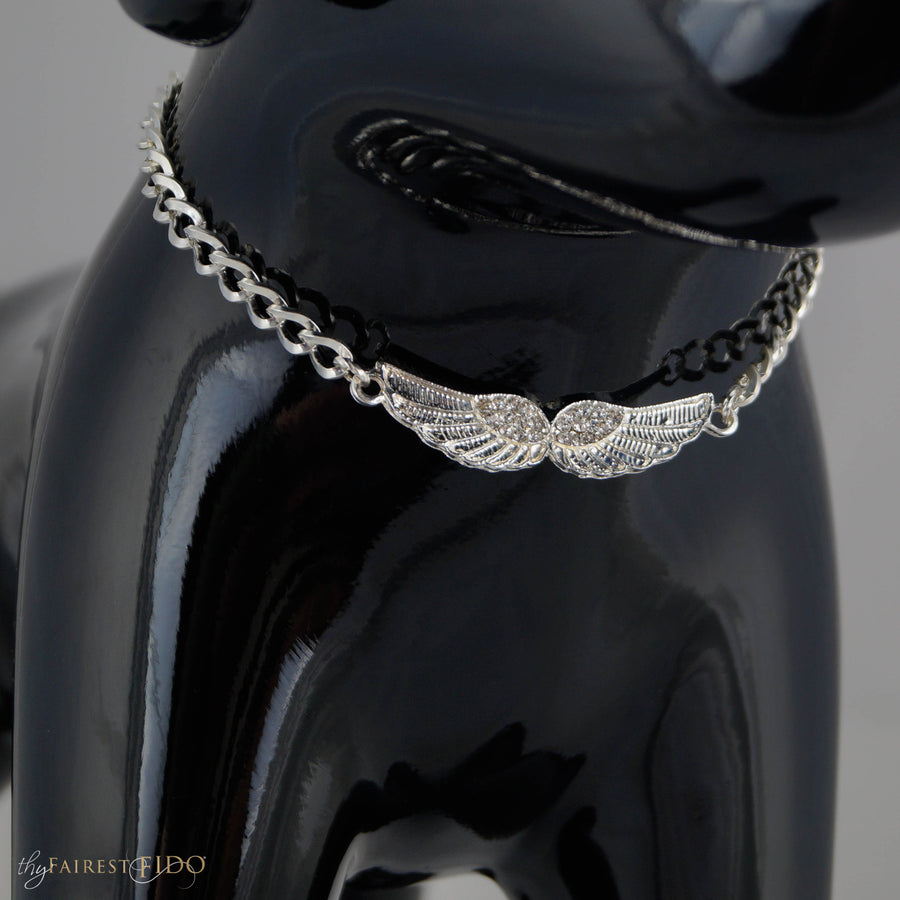 Soaring Pendant, Rhinestone and silver wings stretched open on silver chain