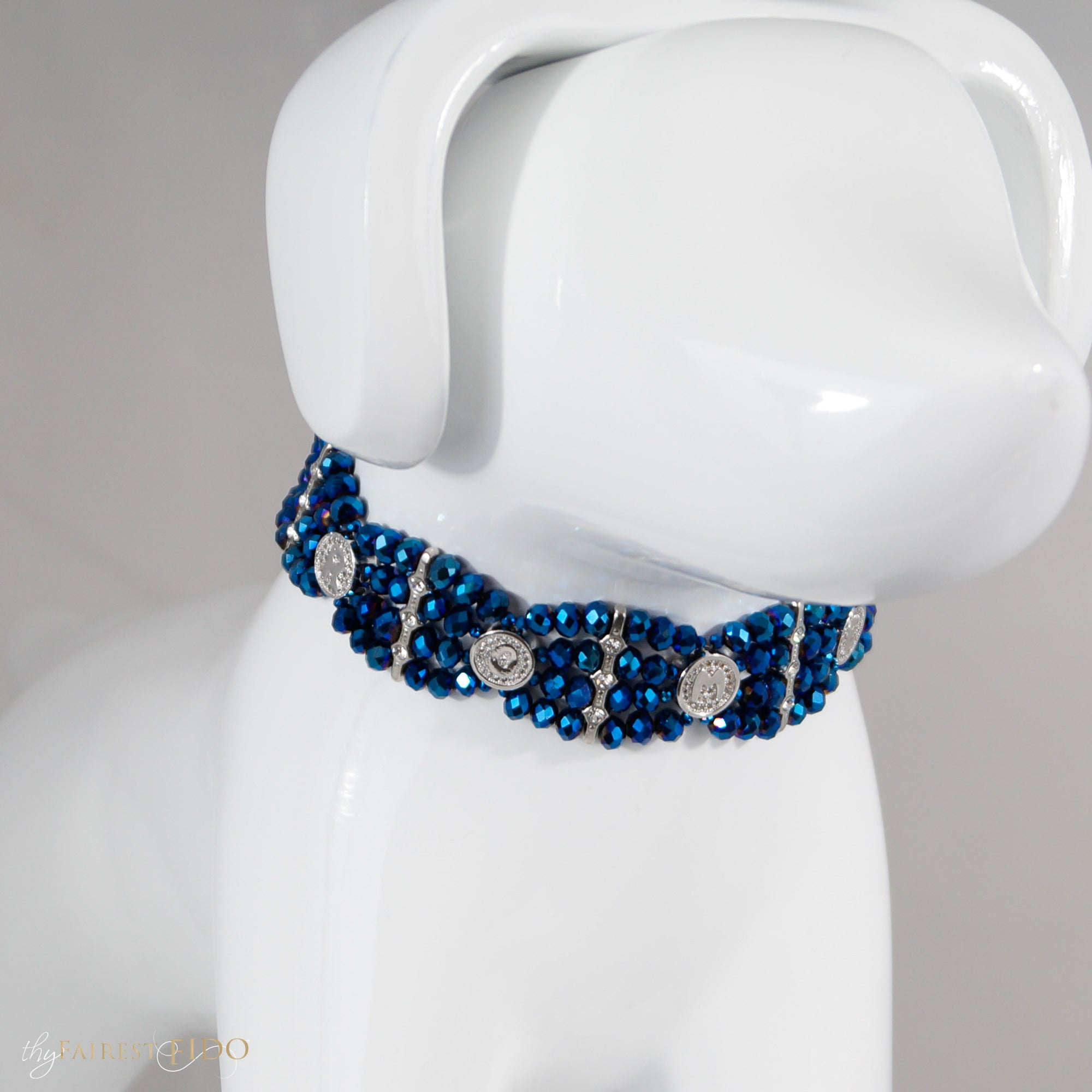 Four rows of Blue crystal woven highlighted with rhinestone spacer bars and round micro pave cubic zirconia silver letters to personalize with dogs name size 0/1