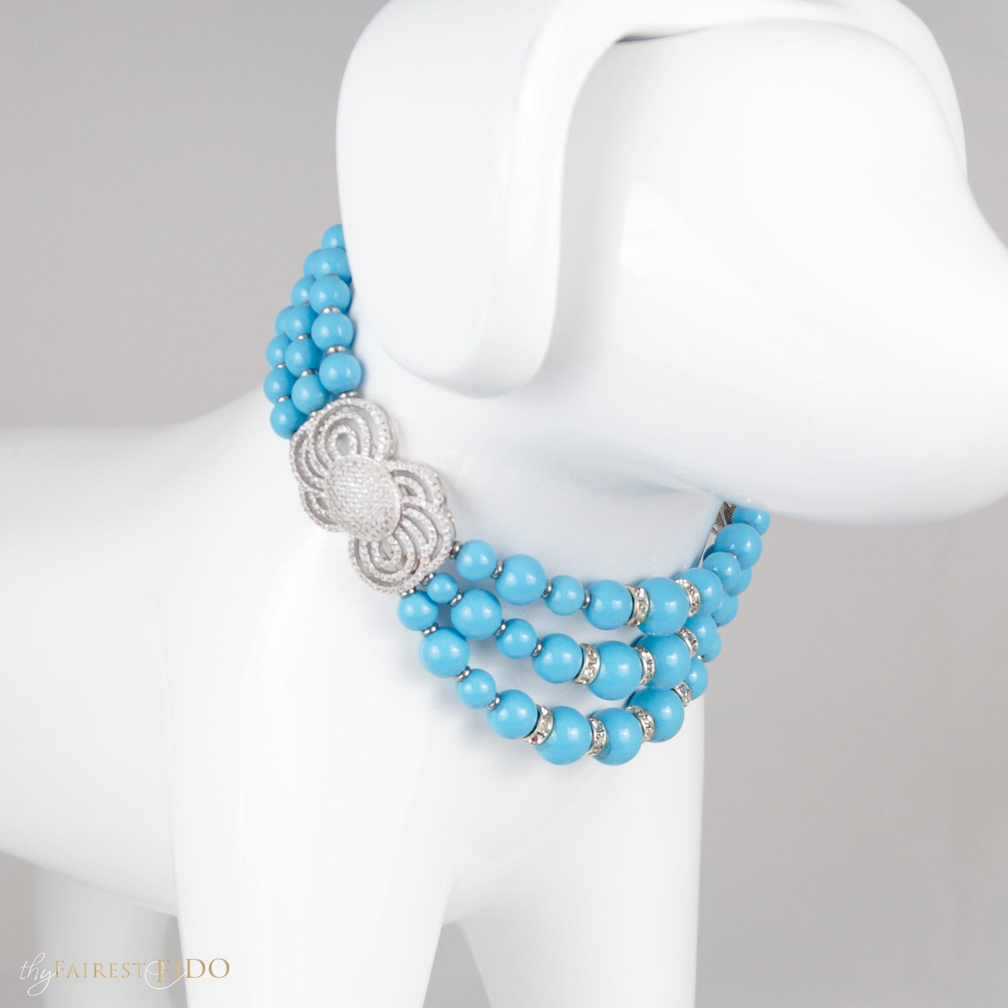 Timeless Beauty, Three row Swarovski pearls with micro pave cubic zirconia bows on sides teal size 1