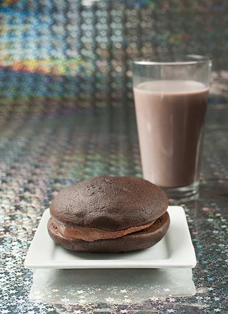 double chocolate chip whoopie pie with chocolate milk in the background