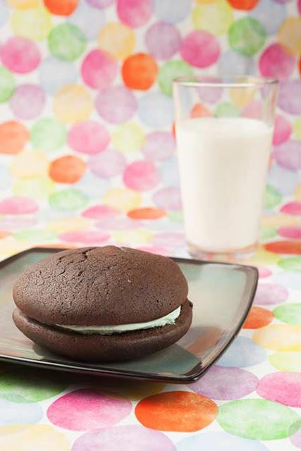 Mint whoopie pie with a glass of milk