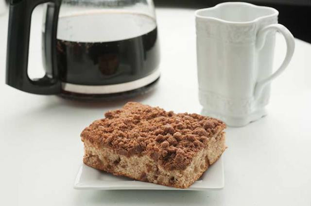 New england coffee cake on a square plate with coffee