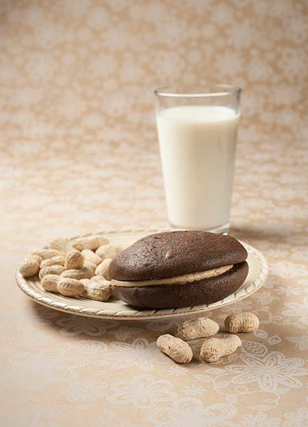 peanut butter whoopie pie with peanuts and milk
