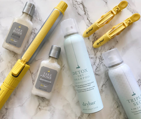 DryBar products including curling iron, shampoo, conditioner, hair clips, dry shampoo