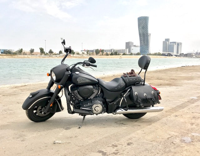 Indian Dark horse with our signature black leather saddlebags and fringe. The bike is parked in Abu Dhabi.