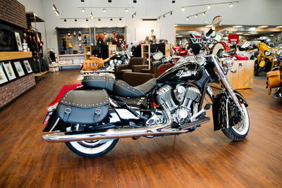 Indian Dealership MOM's South showroom featuring US Saddlebag Co. studded leather saddlebags on Black Indian Chief Classic