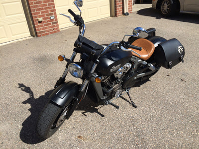 Black Indian Scout with Black Leather Saddlebags and a White Leather Inlay Warrior Head front view