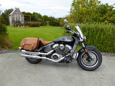 Desert Tan and Black Leather Saddlebags mounted to Black Indian Scout Motorcycle