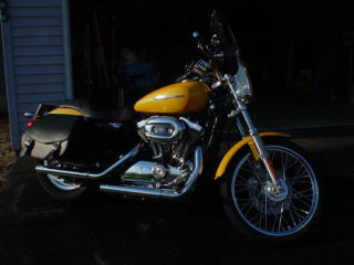 Harley Davidson motorcycle with yellow paint job and US Saddlebag's signature classic black leather saddlebags
