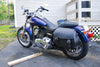 Harley Davidson Dyna Super Glide with blue paint job and US Saddlebag's signature classic black leather saddlebags. Typically a relocation kit is required for this type of build.