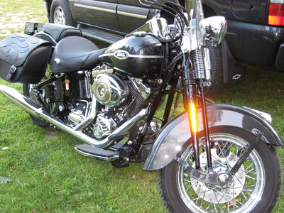 Harley Davidson Softail with black motorcycle saddlebags and a custom black flame leather flap
