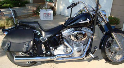 Harley Davidson Softail with black paint job and customized with US Saddlebag's signature classic black leather saddlebags