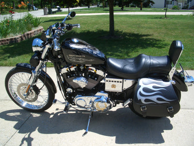 Harley Davidson Sportster with black leather saddlebags and a silver inlay by US Saddlebag Co.