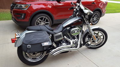 Harley Davidson Dyna Low Rider with black motorcycle saddlebags and a custom black flame leather flap
