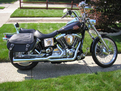 Harley Davidson Dyna Wide Glide with black motorcycle saddlebags and a custom black flame leather flap