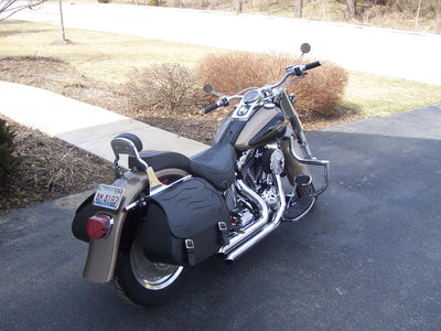 Harley Davidson Fat Boy with black motorcycle saddlebags and a custom black flame leather flap