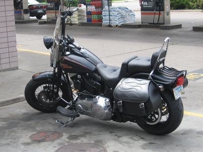 Harley Davidson Softail Springer with black motorcycle saddlebags and a custom black flame leather flap