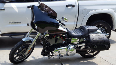 Harley Davidson Softail Standard with black motorcycle saddlebags and a custom black flame leather flap