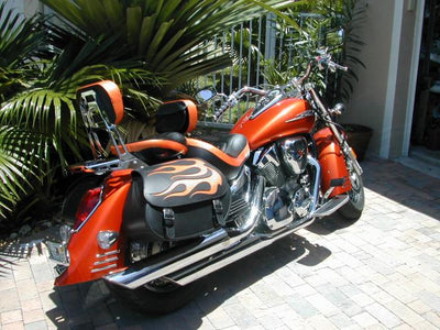 Honda VTX 1300R with US Saddlebag Co's signature black leather saddlebags customized with an orange leather flame.