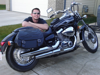Honda Shadow Spirit 750 C2 with black motorcycle saddlebags and a custom black flame leather flap